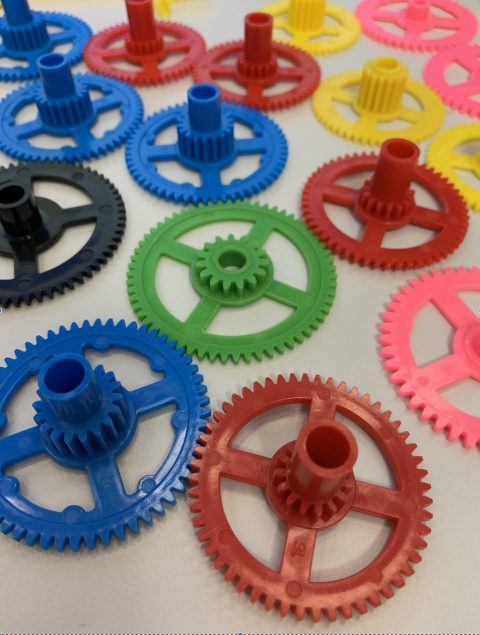 Plastic watch cogs for building a clock